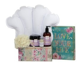 a box with an inflatible pillow with lotions and cream
