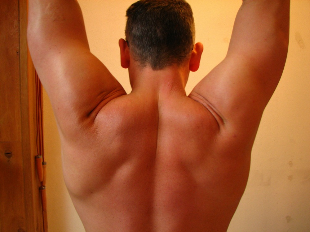 tight neck and back muscles on a man because he's stressed out